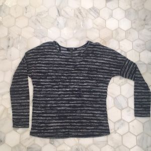 Very light sweater, cropped.